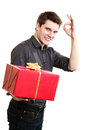 Holiday. Man giving red gift box showing thumb up Royalty Free Stock Photo