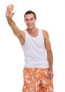 On holiday man in shorts and t-shirt saluting Royalty Free Stock Images