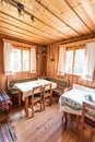 Holiday in the mountains: Rustic old wooden interior of a cabin or hut Royalty Free Stock Photo