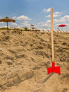 Holiday Playtime, Spade On Beach Royalty Free Stock Image