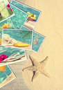 Holiday postcards on sandy wooden decking with starfish Royalty Free Stock Photography
