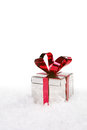 Holiday present in snow with copy space christmas Royalty Free Stock Photo