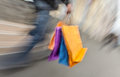 Holiday sales. An elderly man with many shopping bags in his han Royalty Free Stock Photo