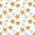 Holiday seamless pattern with gold and silver stars