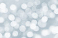 Holiday silver background with blurred lights bokeh Royalty Free Stock Photography
