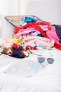 Holiday stuff lying on bed in mess Royalty Free Stock Image