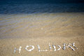 Holiday text made by pebbles in croatian beach nin Stock Photography