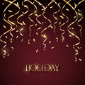 Holiday tinsel and confetti on dark red background