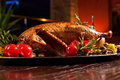 Holiday turkey christmas roast duck served on a festive table Stock Photo