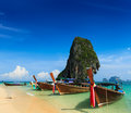 Holiday vacation concept background long tail boat tropical beach limestone rock krabi thailand Royalty Free Stock Images