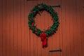 Wreath on red barn siding