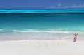 Holiday writing on the desert beach of exuma bahamas Royalty Free Stock Photo