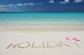 Holiday writing on the sandy beach of exuma bahamas Royalty Free Stock Photography
