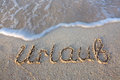Holiday Written in sand at the beach. Royalty Free Stock Photo