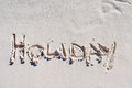 Holiday written on the white sand Stock Photo
