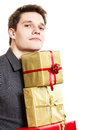 Holiday. Young man giving presents gifts boxes