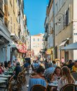 Holidaymakers in Antibes, Cote d`Azur, France sit at a terrace in a restaurant during the summer