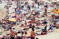 Holidaymakers sunbathing on the beach barcelona spain june in june in barcelona spain barceloneta one of most popular in Royalty Free Stock Photography