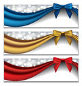 Holidays banners vector set of three elegant with silky ribbons and bows in front of sparkling lights Royalty Free Stock Photography