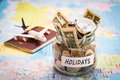 Holidays budget concept with compass, passport and aircraft toy Royalty Free Stock Photo