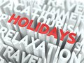 Holidays concept word red color located over text white color Stock Image