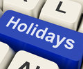 Holidays key means leave or break on keyboard meaning vacation Stock Photo