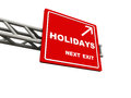 Holidays road sign pointing to arrival of year end celebrations christmas and new year Stock Photography
