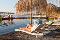 Holidays under parasol in Greece Royalty Free Stock Photography