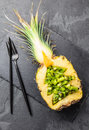 Holidey diet concept or tropical Christmas menu concept. Christmas tree made from pineapple and kiwi on slate board
