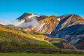In the hollows of rhyolitic mountain snow early summer morning national park landmannalaugar iceland Royalty Free Stock Photography