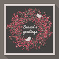 Holly wreath with two pretty birds seasons greetings Royalty Free Stock Images