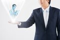 Hologram projection cropped image of businessman holding of his colleague technology and communication concept Stock Images