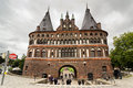 Holstentor in lubeck september people walk along gate on september germany Stock Photography