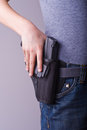 Holstered gun Stock Images