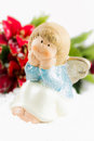 Holy baby angel with poinsettia christmas symbol Royalty Free Stock Photos