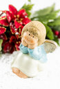 Holy baby angel with poinsettia christmas symbols Royalty Free Stock Image