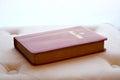Holy Bible backlit on ottoman cushion Royalty Free Stock Photos