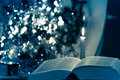 Holy Bible with candle on bokeh Royalty Free Stock Photo