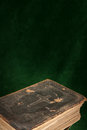 Holy bible on a dark green background Stock Images