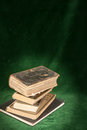 Holy bible on a dark green background Stock Photo