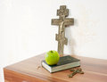 Holy bible with green apple and two crosses Royalty Free Stock Photo