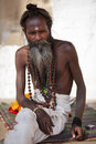 Holy man with bindi and buddhist prayer beads Stock Photos