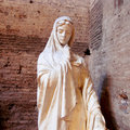 Holy mary artistic statue in a roman church italy Stock Photos