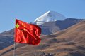 Holy Mount Kailash and Chinese flag Royalty Free Stock Images