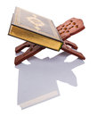 The holy quran on book stand vii islamic scripture a traditional wooden over white background Royalty Free Stock Photo