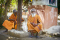 Holy sadhu men in india saffron color clothing blessing shiva temple january tamil nadu tiruvanamalai Stock Photography