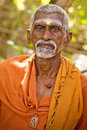 Holy sadhu men in saffron color clothing blessing in shiva temple january in india tamil nadu tiruvanamalai Stock Photography