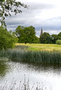 Holy trinity church ratcliffe on soar scenic view of the beautiful peaceful river as it approaches it s mouth where it joins the Stock Photography