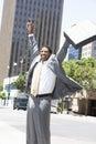 Hombre de negocios with arms raised Imagenes de archivo