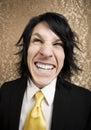Hombre de negocios del rock-and-roll con una sonrisa grande Fotografía de archivo